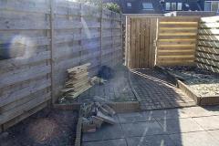 Volledig bestrate tuin opnieuw vormgeven.